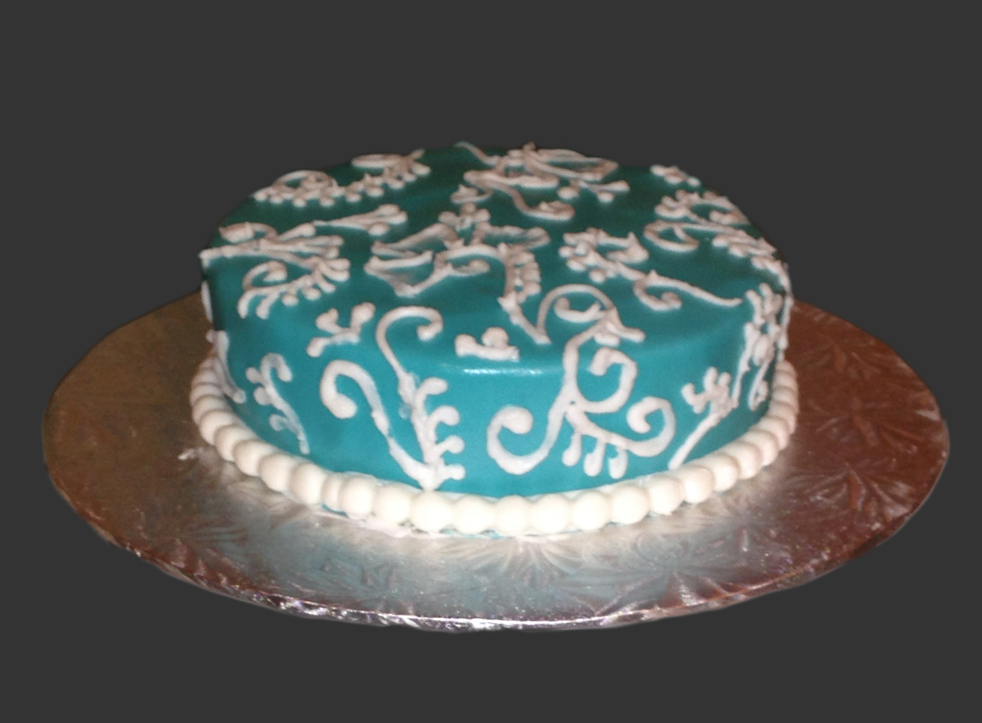 Teal Piped Cake